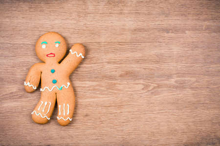 Gingerbread Man on wood  Christmas card background