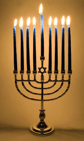 Menorah with all 9 candles lit Stock Photo