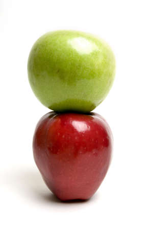 Green apple on top of the red one Stock Photo