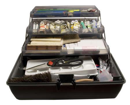 Work toolbox of an artistdesigner, full of paints, pensiles, erasers, etc.