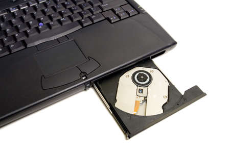 dvdr: Close-up of the laptop with open optical drive in front. Isolated on white background, has room for ad or other text Stock Photo