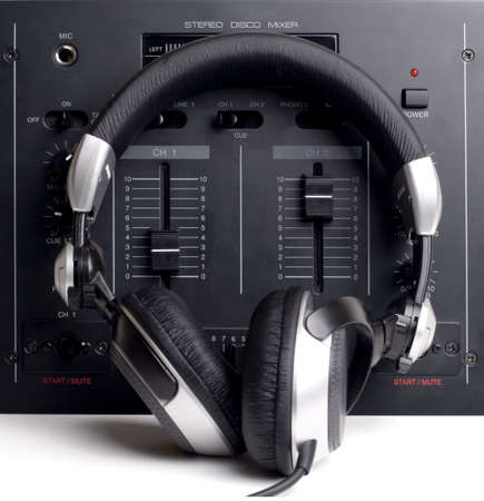 Basic DJ's setup with mixer and headphones. White space for text. Stock Photo - 333524