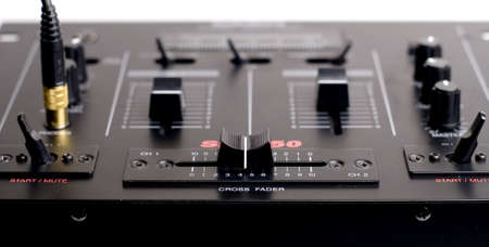 Closeup of the DJ crossfaderMixer w headphones plugged in Stock Photo