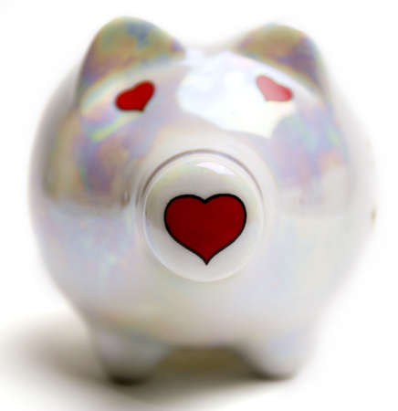Cute ceramic piggy bank with hearts instead of the eyes and nose