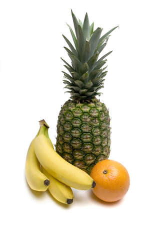 Bananas, pineapple and an orange isolated on the white background