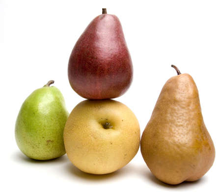 Four different sorts of pears together, isolated against white background.