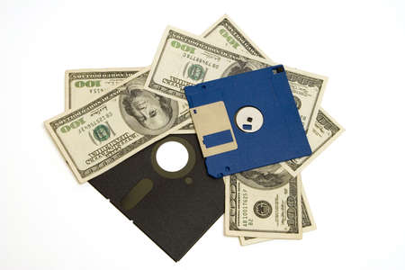 Floppy diskettes and 100 dollar bills, representing wasting money on legacy software. Isolated (clipping path) Reklamní fotografie