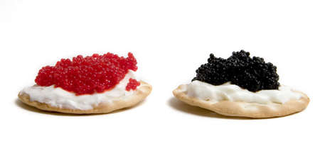 Red and black caviar on crackers with sour cream
