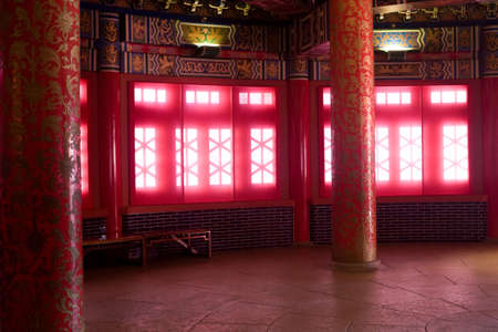 Beautiful room inside Chinese palace with windows that glow with diffused sunlight