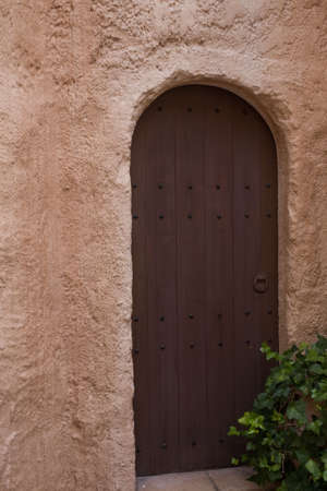 Morocco style door in the stone wall Stock Photo