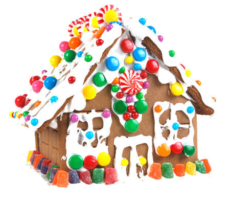 yellow house: Gingerbread house decorated with icing and colorfull candies.