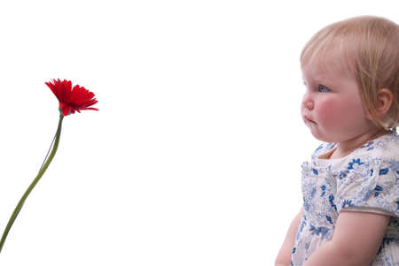 Child gives her mother flowers for Mothers Day