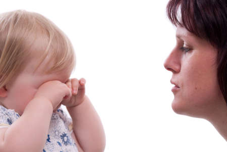 comforted: sad child is comforted by her mother