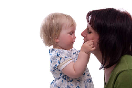 embracement: happy child with her mother on Mothers Day Stock Photo