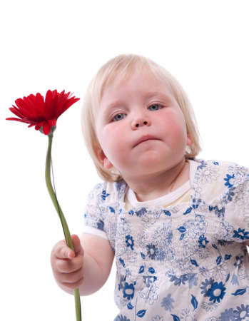 Child gives her mother flowers for Mothers Day photo