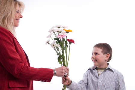 child gives his mother a gift for Mothers Day