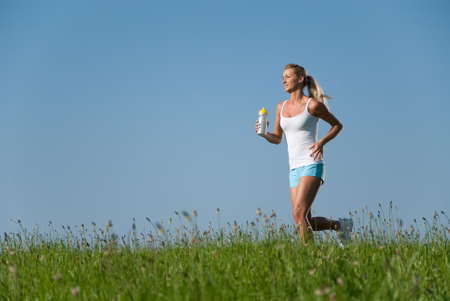 running pants: young woman running in her spare time in the nature Stock Photo
