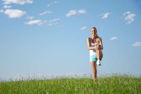 Young woman is doing fitness exercise in the nature Stock Photo - 7504260