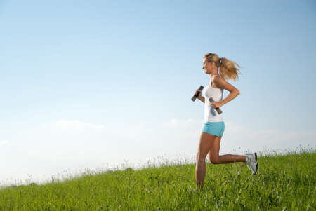 spare time: young woman running in her spare time in the nature Stock Photo