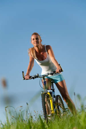 spare time: young woman cycling in her spare time