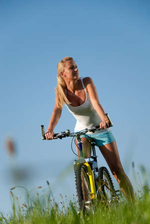 young woman cycling in her spare time