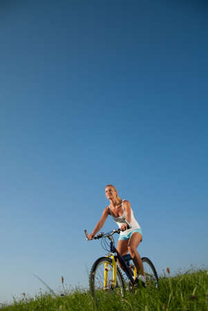 young woman mountainbiking in her spare time Stock Photo