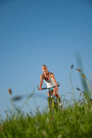 young woman mountainbiking in her spare time photo