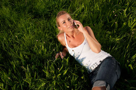 young woman communicates by phone outdoors Stock Photo