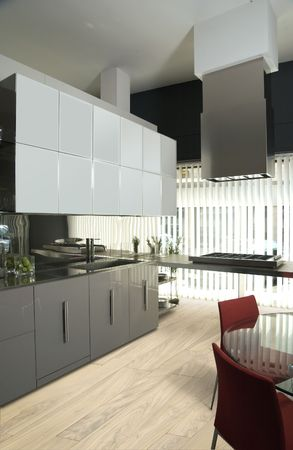 modern luxury kitchen with olive tree  parquet photo