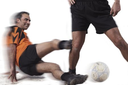 a football player  shoot the knee of the opposer