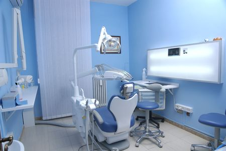 dental tools: modern Dentists chair in a medical room Stock Photo
