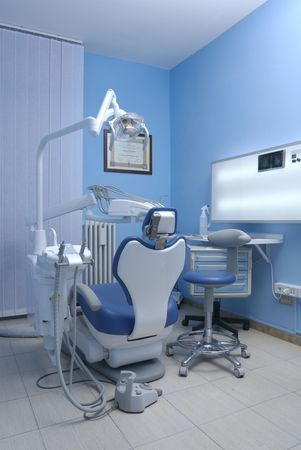 dentist mask: modern Dentists chair in a medical room Stock Photo