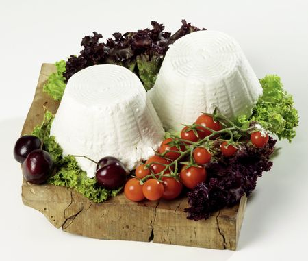 fresh ricotta cheese isolated on cutting board