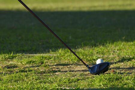 golf iron and ball photo