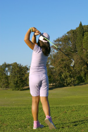 young golf player trying a shot photo