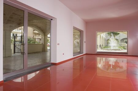 empty space with red tiled floor