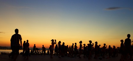 loud music: A crowd of people gather by the Mekong river at sunset to dance to loud music until they drop in Vientiane city, Laos.