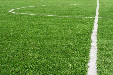 Green football Soccer field with artificial grass marking