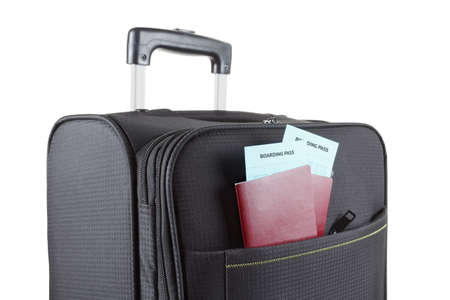 boarding: Airline ticket, passport and luggage isolated on white