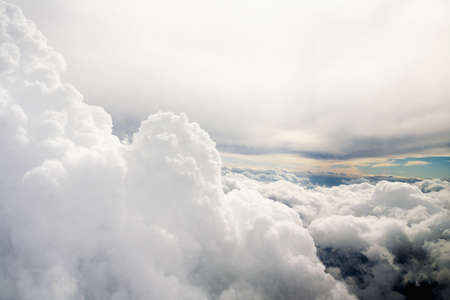 wallpaper: Clouds and sky as seen through window of an aircraft