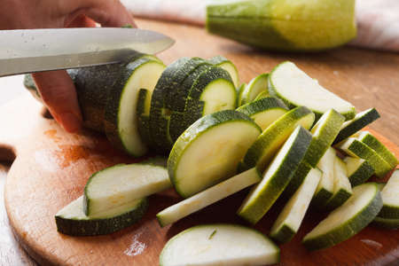 cut: Cut zucchini on chopping board for cooking Stock Photo