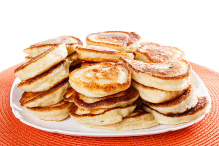 flapjacks: stack of homemade pancakes flapjacks on a white plate closeup Isolated on white