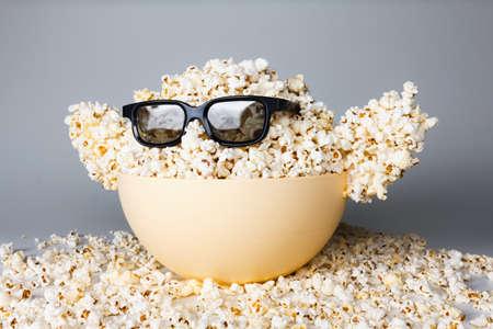 farce: Smiling Monster of popcorn, glasses. Cinema, the audience watching comedy humor Stock Photo