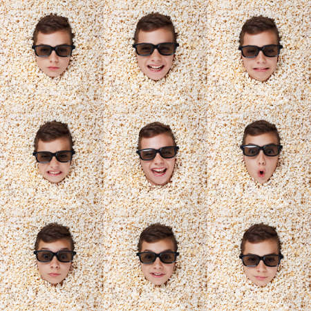 melodrama: Set grimace, facial expressions. Young boy in stereo glasses, popcorn Stock Photo