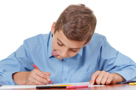 enthusiastically: Teenager enthusiastically doing homework on a white background isolate