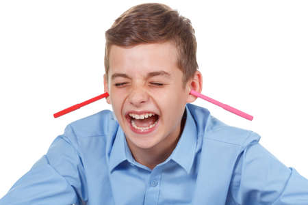 prankster: Happy teen. Pencils mess at home. Funny way to have fun. Kid enjoying his free time playing. Stock Photo