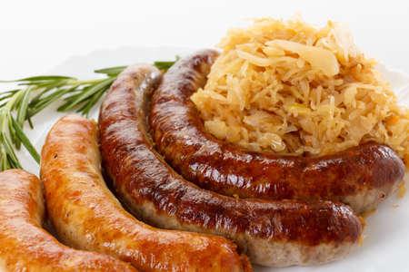 bier festival: Delicious octoberfest menu, plate of sausages and sauerkraut. Oktoberfest meal.