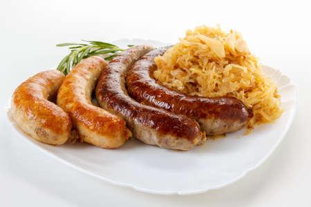 wiesn: Delicious octoberfest menu, plate of sausages and sauerkraut. Oktoberfest meal.