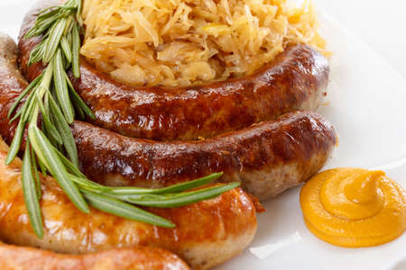 bier festival: Traditional Octoberfest menu, plate of sausages and sauerkraut. Oktoberfest meal.