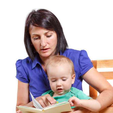 Mother reading a book to his mischievous kid. Studio isolated on white Imagens